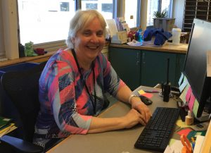 Deb McNally working in the office at Moreau.
