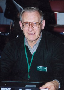 Man wearing glasses and a lanyard