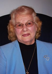 Woman wearing blue blazer and glasses