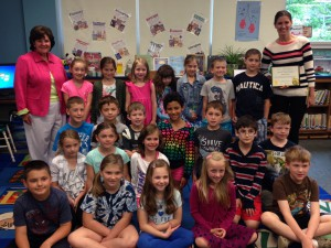 Teacher Jusine Greco with Senator Kathleen Marchione and her second-grade class