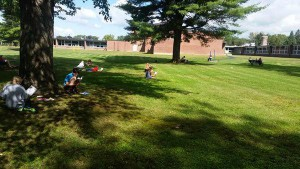 Students in Alissa MacDonald's class read outside earlier this year.