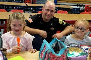 SGFCSD SRO Mark Stewart with Moreau Elementary School students in the cafeteria.