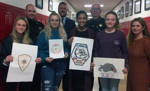 Students with winning artwork