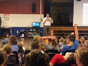 John Gray speaks to students at Moreau Elementary School