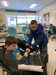 Students work on Genius Hour projects together.