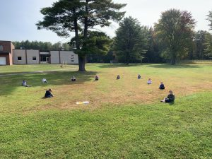 Students participating in Open Circle outside.